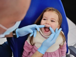 toddler with dentist